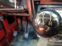 Car shift knob with speed numbers. Closeup of a car 5 speed gearstick royalty free stock photo