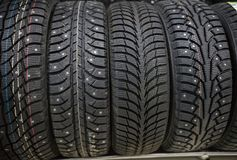 A car shop. Brand new clean wheels with studded tires. Close up royalty free stock photo