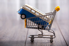 Car in a shopping basket Stock Image