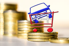 Car and shopping cart on background of money . Stock Photography