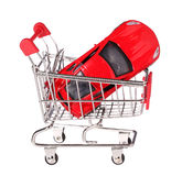 Car in shopping cart concept isolated on white Royalty Free Stock Photos