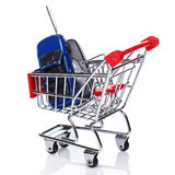 Car in shopping trolley. Over white background Royalty Free Stock Photography