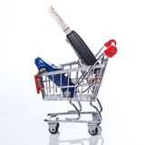 Car in shopping trolley. Over white background Stock Photos