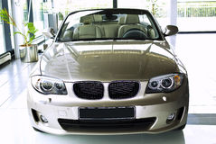 Car in showroom. Sport convertible automobile stock image