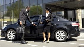 Car showroom consultant showing luxury car to buyer, vehicle leasing business. Stock photo stock image