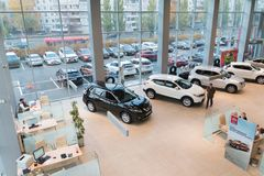 Car in showroom of dealership Nissan in Kazan city. View from the top. Kazan, Russia - October 19, 2017: Car in showroom of dealership Nissan in Kazan city. View royalty free stock photography