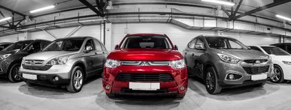 Free Car Showroom Of City Crossovers Royalty Free Stock Photos - 108933408