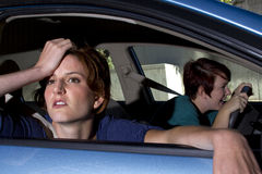Car Sick. Close up of passenger women being car sick royalty free stock image