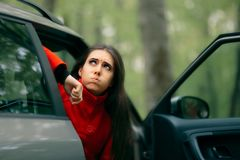 Car Sick Woman Having Motion Sickness Symptoms. Suffering girl in a pulled over automobile trying to recover from travel sickness royalty free stock photos