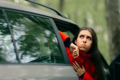 Car Sick Woman Having Motion Sickness Symptoms. Suffering girl in a pulled over automobile trying to recover from travel sickness royalty free stock photography