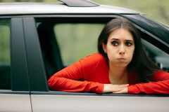 Car Sick Woman Having Motion Sickness Symptoms. Suffering girl in a pulled over automobile trying to recover from travel sickness stock photos
