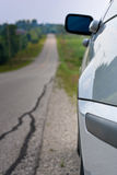 Car at side of long road Royalty Free Stock Photography