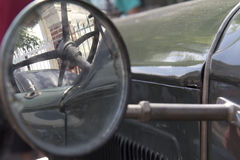 Car side mirror. Old car side mirror of a vintage automobile Stock Image