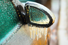 Car side mirror covered with ice Royalty Free Stock Images