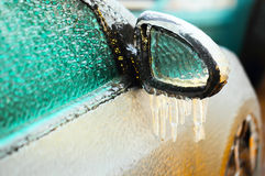 Car side mirror covered with ice Royalty Free Stock Photo