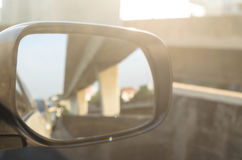 Car Side Mirror. Car Side Mirror and looking back has traffic jam in the morning Stock Photos
