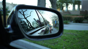 Car side mirror reflection. The reflection from the car side mirror royalty free stock photography