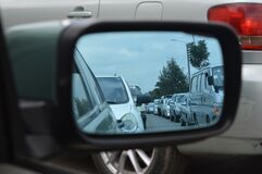 Car Side Mirror Showing Heavy Traffic Royalty Free Stock Images