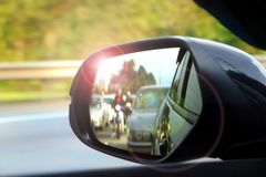 Car side mirror view with sunlight glare Royalty Free Stock Images