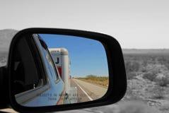 Car side mirror with view U-Haul behind. PHOENIX AZ - OCTOBER 04: car side mirror with view U-Haul behind Phoenix Arizona 2013 Stock Images