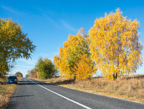 Car is on the side of the road, autumn Stock Images