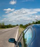 Car on the side of the road with skies reflecting on the glass royalty free stock photography