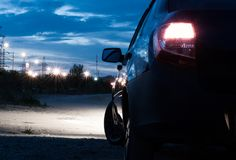Car side view. red lights. Summer, great weather and night rides around the city. Red is the main theme of summer royalty free stock images