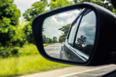 Car side window reflex on the road. Royalty Free Stock Photography