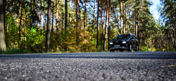 Car silhouette. Road, car and forest background Stock Image