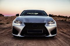 A car in silver color without logos in the desert in golden hour.  royalty free stock image