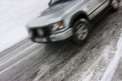 Car skidding on an icy road Royalty Free Stock Images