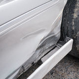 Car skirt damaged by accident Royalty Free Stock Photography