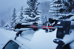 Car with skis on the roof rails at winter forest Royalty Free Stock Photo