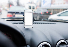Car with Smartphone in holder. Royalty Free Stock Photography