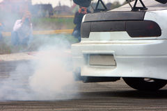 Car smoke. EXHAUST PIPE OF A CAR BLOWING Royalty Free Stock Photo