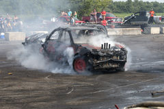 Car smoke show. Napierville demolition derby, July 12, 2015, picture of wrecked car making a smoke show during the demolition derby royalty free stock photo