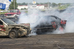 Demolition derby. Napierville demolition derby, July 12, 2015, picture of wrecked car making a smoke show during the demolition derby royalty free stock images