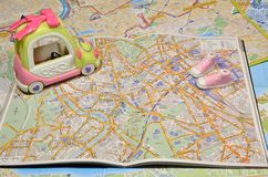 Car and sneakers on map. Plastic toy car and sneakers on the map of Rome Stock Photography