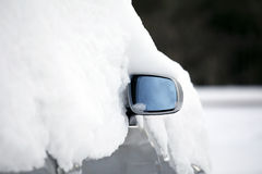 Car in the snow. Snow covered the car, just showed a car mirror Stock Photo