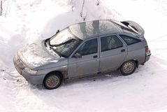 The car on snow. The automobile personal car costs on snow-covered parking Stock Photo