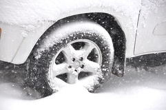 Car in Snow. Car tire stuck in snow after a winter storm royalty free stock photography