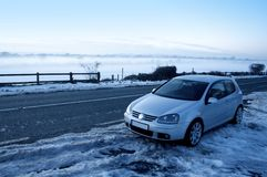 Car in the snow. And fog royalty free stock photos