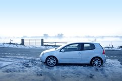 Car in the snow. Side view royalty free stock photo