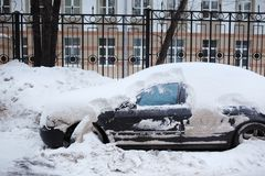 Car in snow. Car covered with snow after snowstorm. Winter royalty free stock photo