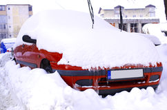 Car and snow. Parked car covered and stuck in snow stock photography