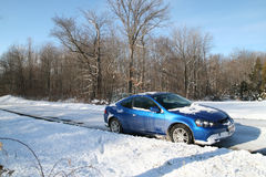 Car in Snow. Blue sports car stopped on a snowy country road in Ohio Stock Photography