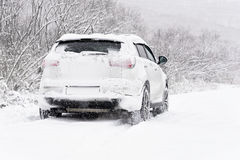 Car in the snow. Blizzard. Car in the snow. Winter road after snowfall royalty free stock image