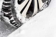 Car in the snow. Closeup of car tires in winter stock image