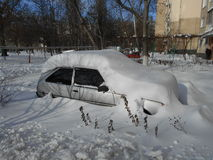 Car in the snow drifts Stock Image