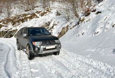 Car on the snow road Royalty Free Stock Photography